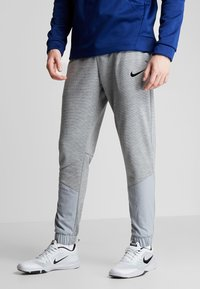 Nike Performance - DRY PLUS - Tracksuit bottoms - particle grey/heather/black - 0