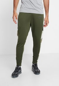 Nike Performance - CAMO - Tracksuit bottoms - cargo khaki/black - 0