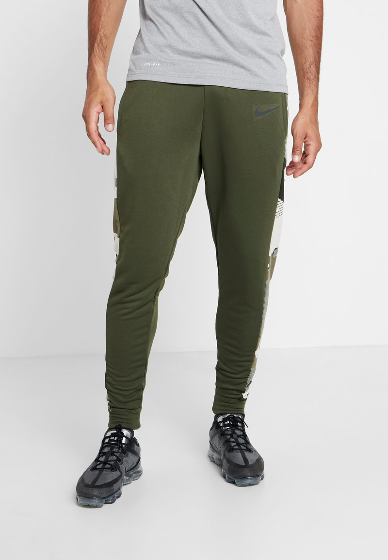 Nike Performance - CAMO - Tracksuit bottoms - cargo khaki/black