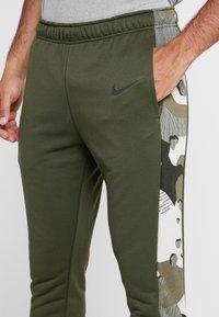 Nike Performance - CAMO - Tracksuit bottoms - cargo khaki/black - 4
