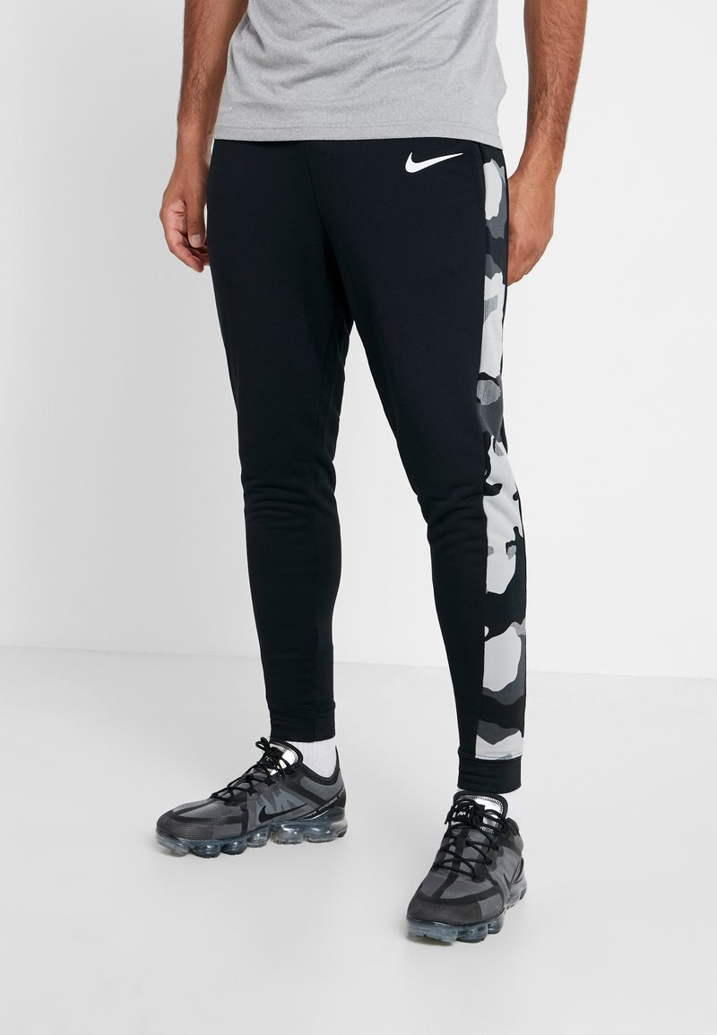 Nike Performance - CAMO - Tracksuit bottoms - black/smoke grey/white