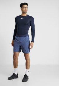 Nike Performance - M NK FLX SHORT YOGA - Short de sport - midnight navy/ocean fog/black - 1