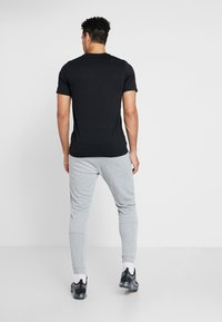 Nike Performance - Trainingsbroek - grey heather/black - 2