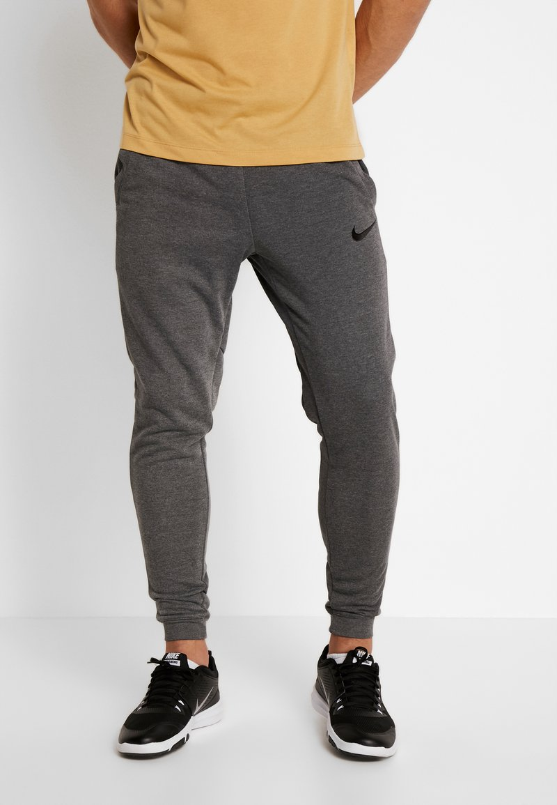 Nike Performance - Tracksuit bottoms - charcoal heather/black