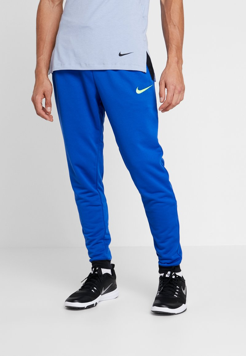 Nike Performance - Jogginghose - game royal/black/habanero red/electric green