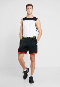 Nike Performance - Pantaloncini sportivi - black/sequoia/habanero red/electric green - 1