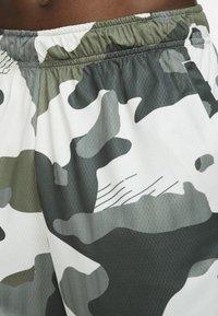 Nike Performance - Sports shorts - off-white/black - 6