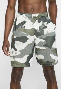 Nike Performance - Sports shorts - off-white/black - 3