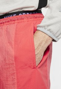 Nike Performance - FLEX PANT - Pantalon de survêtement - orange - 3