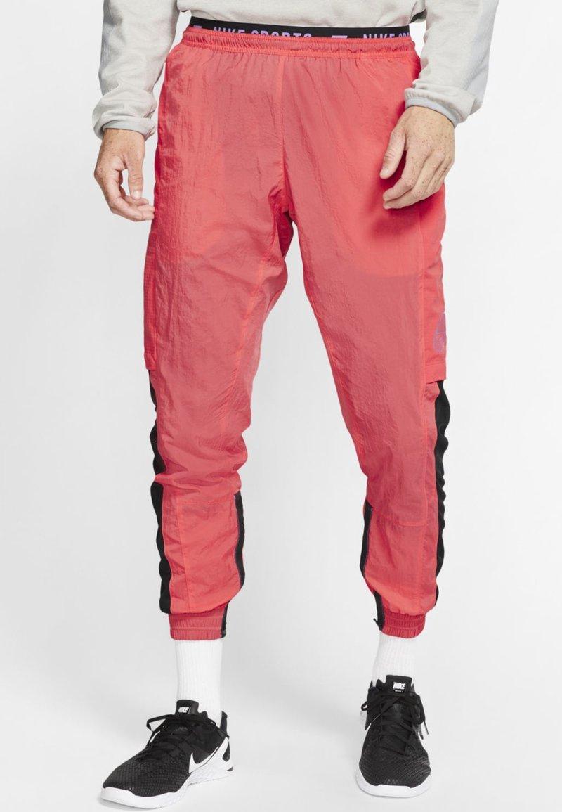 Nike Performance - FLEX PANT - Pantalon de survêtement - orange