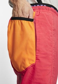 Nike Performance - FLEX PANT - Pantalon de survêtement - orange - 6