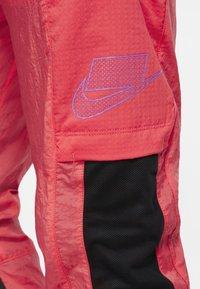 Nike Performance - FLEX PANT - Pantalon de survêtement - orange - 4