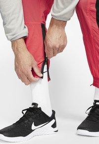 Nike Performance - FLEX PANT - Pantalon de survêtement - orange - 5