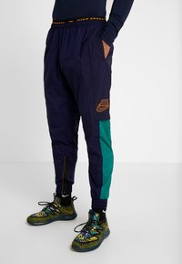 Nike Performance - FLEX PANT - Joggebukse - blackened blue/kumquat - 0