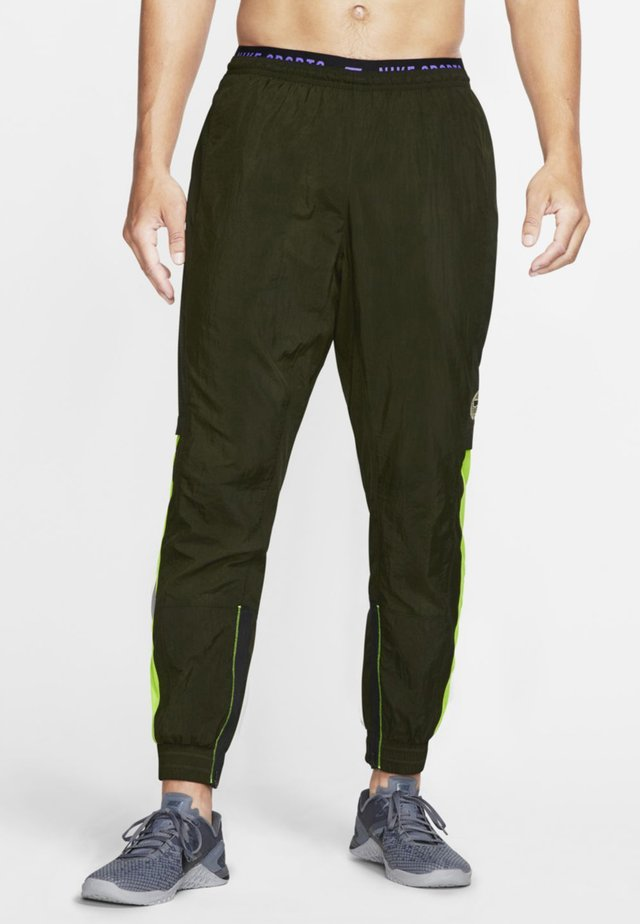 FLEX PANT - Tracksuit bottoms - sequoia/black/electric green/pale ivory