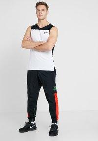Nike Performance - FLEX PANT - Teplákové kalhoty - black/sequoia/habanero red/electric green - 1