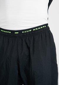 Nike Performance - FLEX PANT - Teplákové kalhoty - black/sequoia/habanero red/electric green - 3