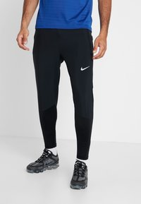 Nike Performance - ESSENTIAL PANT - Pantalon de survêtement - black/reflective silver - 0