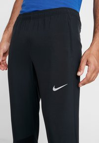 Nike Performance - ESSENTIAL PANT - Trainingsbroek - black/reflective silver - 6