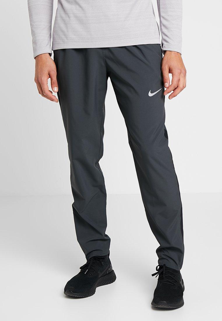 Nike Performance - RUN STRIPE PANT - Tracksuit bottoms - dark smoke grey/reflective silver