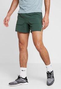 Nike Performance - SHORT - Träningsshorts - galactic jade/blackreflective black - 0