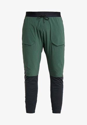 PANT - Pantalones deportivos - galactic jade/black/reflective black