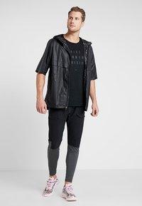 Nike Performance - PANT - Tracksuit bottoms - black/anthracite - 1