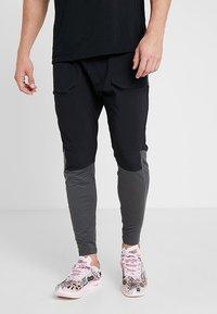 Nike Performance - PANT - Tracksuit bottoms - black/anthracite - 0