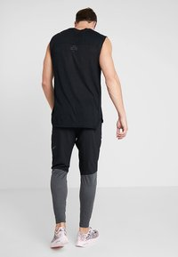 Nike Performance - PANT - Tracksuit bottoms - black/anthracite - 2
