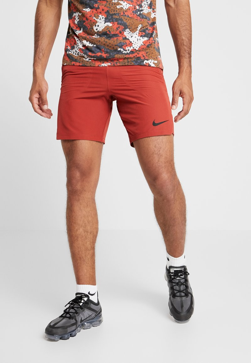 Nike Performance - FLEX REPEL SHORT - Pantalón corto de deporte - dune red