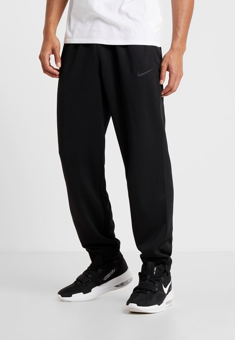 Nike Performance - SPOTLIGHT PANT - Tracksuit bottoms - black/anthracite