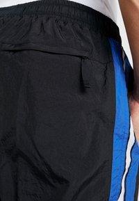 Nike Performance - THROWBACK PANT  - Pantalones deportivos - black/game royal - 5