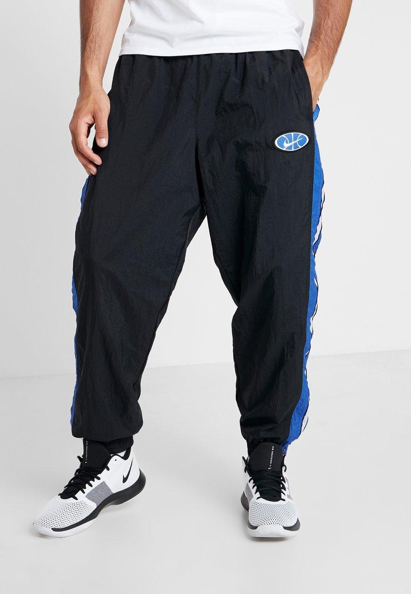 Nike Performance - THROWBACK PANT  - Pantalones deportivos - black/game royal