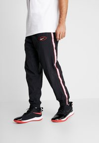 Nike Performance - THROWBACK PANT  - Tracksuit bottoms - black/white - 0