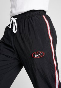 Nike Performance - THROWBACK PANT  - Tracksuit bottoms - black/white - 3