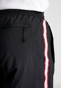 Nike Performance - THROWBACK PANT  - Tracksuit bottoms - black/white - 5