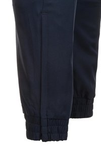Nike Performance - Tracksuit bottoms - obsidian/white