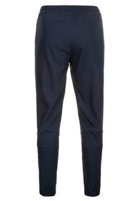 Nike Performance - Tracksuit bottoms - obsidian/white - 1