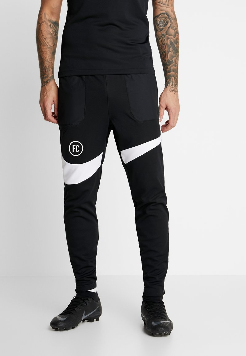 Nike Performance - PANT - Verryttelyhousut - black/white