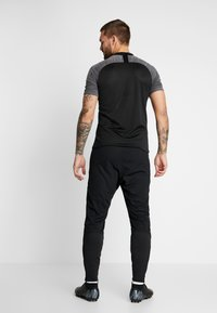 Nike Performance - PANT - Verryttelyhousut - black/white - 2