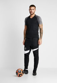 Nike Performance - PANT - Verryttelyhousut - black/white - 1