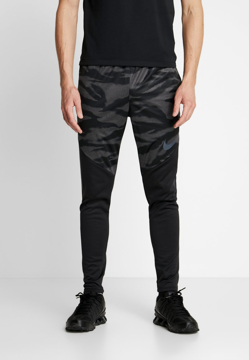 Nike Performance - THERMA SHIELD STIRKE PANT - Tracksuit bottoms - black/anthracite