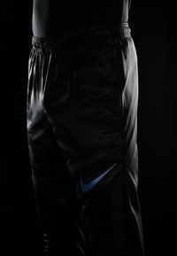 Nike Performance - THERMA SHIELD STIRKE PANT - Tracksuit bottoms - black/anthracite - 4