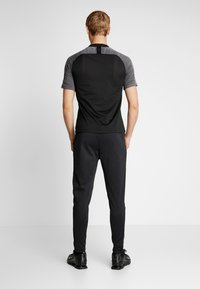 Nike Performance - THERMA SHIELD STIRKE PANT - Tracksuit bottoms - black/anthracite - 2