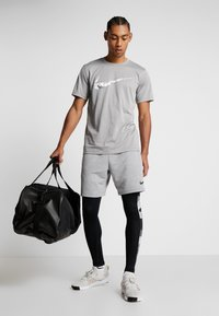 Nike Performance - CAMO - Tights - black/white - 1