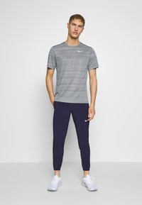 Nike Performance - ESSENTIAL PANT - Pantalones deportivos - imperial purple/reflective silver - 1