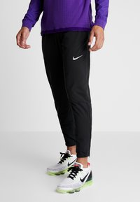 Nike Performance - THRMA PANT  - Tracksuit bottoms - black/reflective silv - 0