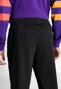 Nike Performance - THRMA PANT  - Tracksuit bottoms - black/reflective silv - 7