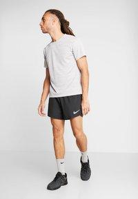 Nike Performance - DRY SHORT FAST - Pantalón corto de deporte - black/reflective silver - 1