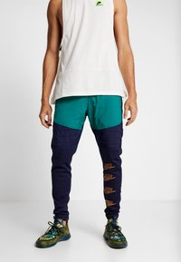 Nike Performance - PANT - Tracksuit bottoms - blackened blue/mystic green/kumquat - 0